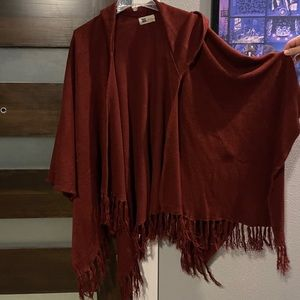 Dark red/maroon cape with fringe and hood